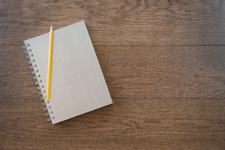 office space: notebook with pencil on office wooden table with copy space