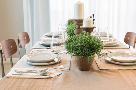 vase of plant on wooden table  in modern dinning room design