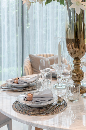 table set on round table dining in luxury dining room, interior design