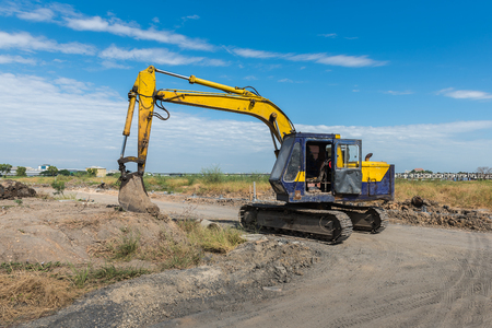 precast: construction site with dirty yellow excavator during work for precast housing