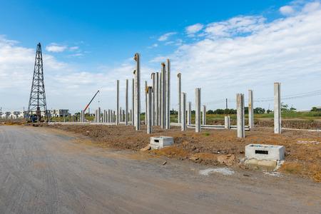 precast: consruction site with  precast concret pile and pile-driver, prefabrication house structure design