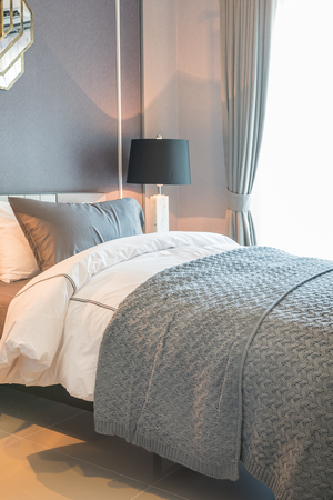 hotel bedroom: single bed with black lamp in classic style bedroom, interior design concept