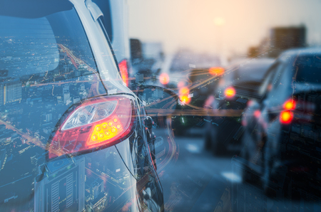 double exposure of traffic jam with row of cars on expressway during rush hour, vintage style process Stock Photo