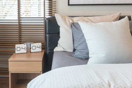 luxury apartment: king bed size with set of pillws and set of tea on tray in classic bedroom style, interior design concept