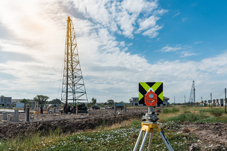 civil engineering and construction projects with survey equipment tacheometer or theodolite outdoors at construction site
