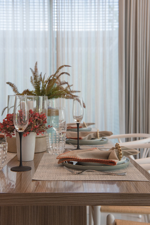 table set on wooden dining room, interior design concept