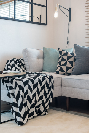 modern living room with set of pillows on sofa; interior design concept Foto de archivo