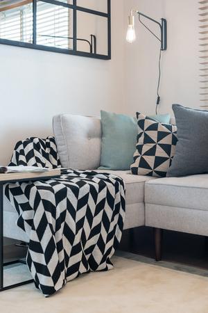 modern living room with set of pillows on sofa; interior design concept Archivio Fotografico