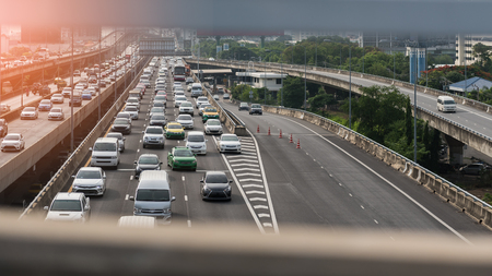 traffic jam with row of cars on toll way, during rush hour