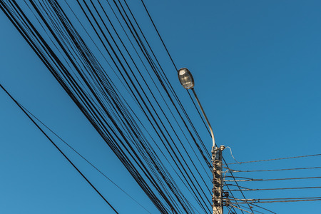 street light, electric spotlight pole with blue sky as background