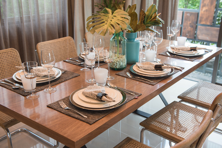 luxury table set on wooden dining table in classic dining room, interior design concept