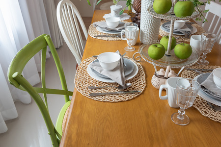 modern table set on wooden dining table in modern dining room, interior design concept Stock Photo