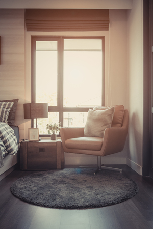 modern bedroom with set of sofa and table side on carpet, interior decoration design concept, vintage style process