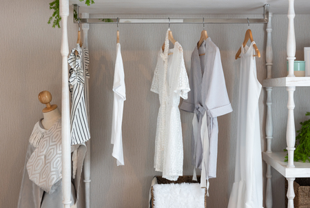 classic closet style with clothes hanging, white color tone wardrobe with clothes, interior decoration design concept 版權商用圖片