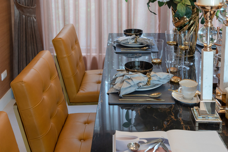 classic style table set on dining table in modern dining room, interior design concept