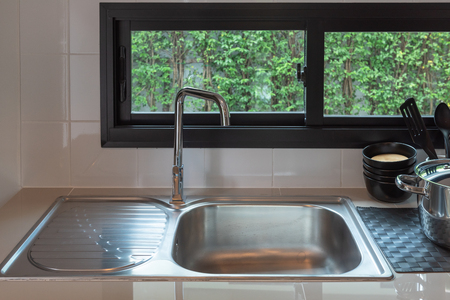 sink with faucet in kitchen room, modern counter with sink in kitchen room, interior design concept Stock Photo
