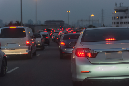 traffic jam on main street with row of cars in downtown, central businees distric before night 版權商用圖片 - 120398546