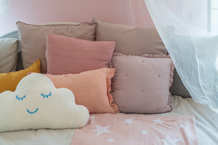 beautiful kid's bedroom with set of pillows on cozy bed, interior design decoraion concept 写真素材