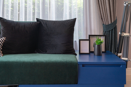 modern living room in blue color tone with set of pillows on modern sofa, interior design decorTION