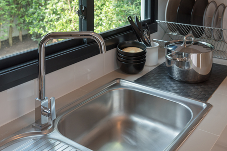 sink with faucet in kitchen room, modern counter with sink in kitchen room, interior design concept Banco de Imagens
