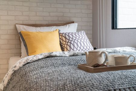 modern bedroom style with set of pillows on bed, interior design decoration concept 版權商用圖片