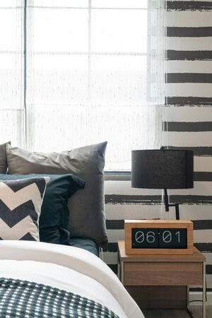 modern balck and white color tone bedroom with set of pillows, interior design decoration concept
