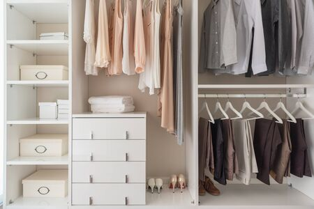 modern wardorbe with set of clothes hanging on rail, modern closet interior design concept