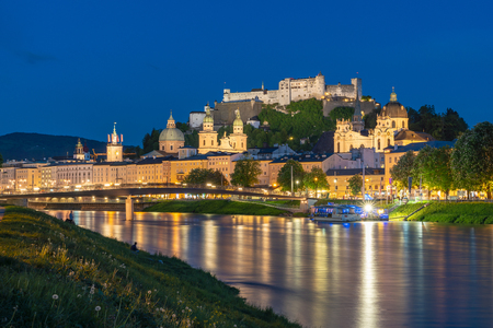 Classic view of historic city, beautiful view of Salzburg skyline with Festung Hohensalzburg and Salzach river in summer at night, Salzburg,Austria