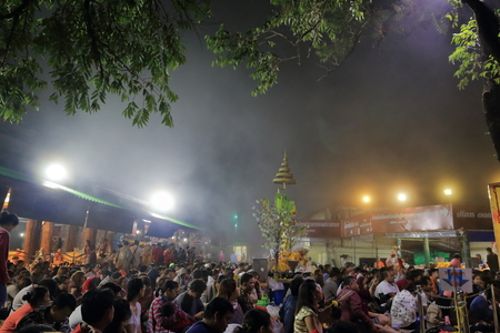 waited: The crowd waited for morning prayer on the khao khitchakut mountain at night and fog of Thailand.