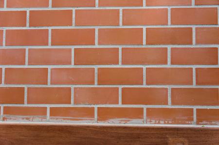 base: brick background with wood base