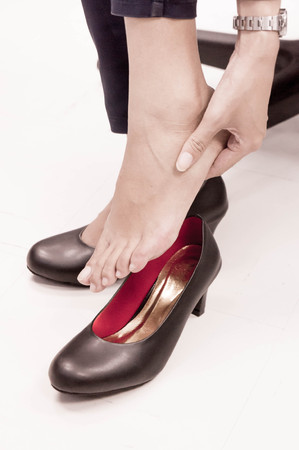 high heel: high heel related injuries Stock Photo