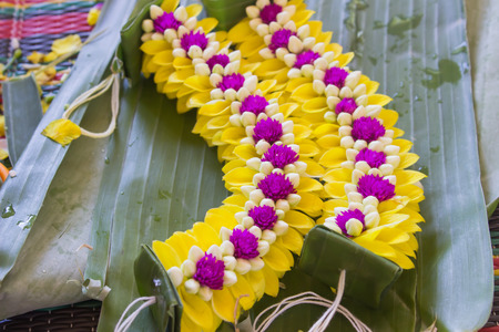 evergreen wreaths: Yellow garlands placed on the floor of banana leaves.