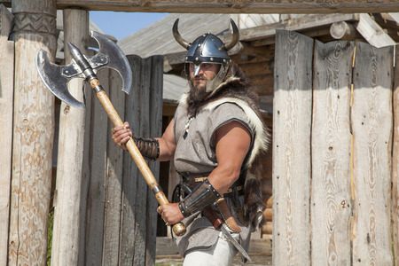 viking helmet: strong real Viking outside his home Stock Photo