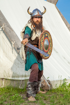 viking helmet: Strong viking is defending near his territory Stock Photo