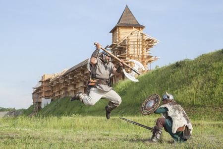 castle buildings: War between vikings Stock Photo