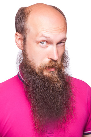 funny bearded man: Portrait of a funny bald bearded man against a white background. isolated, studio shot.