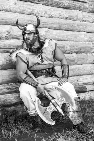 The portrait of the Viking with his axe, black and white. Stock Photo
