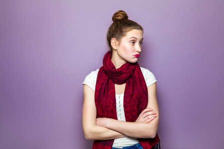 sarcastic: Thinking girl. Portrait closeup funny confused skeptical woman girl female thinking trying to recall looking upwards purple wall background. Human expressions emotions feelings body language. Stock Photo
