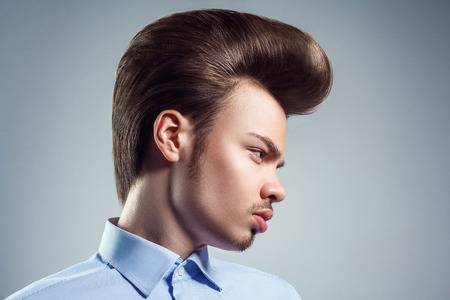 Side view of young man with retro classic pompadour hairstyle. studio shot. Stock Photo