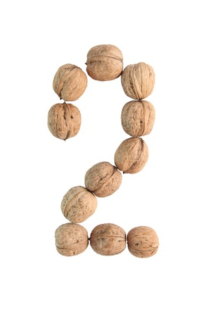 numeric: The group of walnuts on white background, making number 2. Studio shot