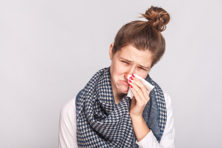 Allergy or virus concept. Closeup portrait of sick woman. Studio shot Stock Photo
