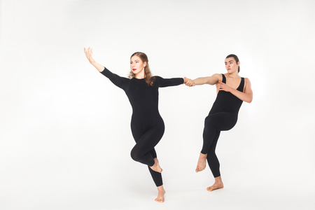 Harmony, partnership. Friends holding hands and dancing. Studio shot, isolated on white background