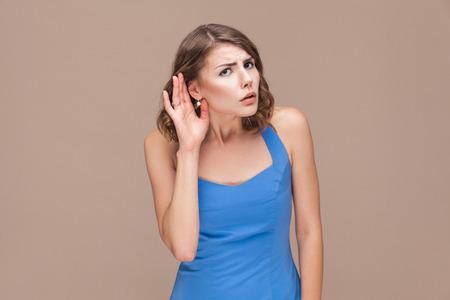 Businesswoman not hear you. Studio shot