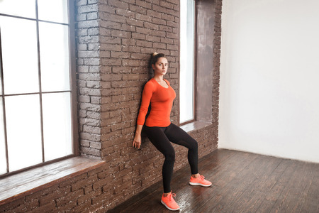 Balancing exercise. Activity woman looking at camera and doing workout. Studio shot Stockfoto