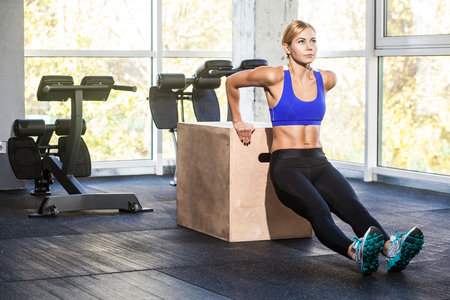 Woman doing push up on triceps. Studio shot
