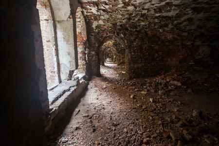 weathered dark corridor of old fortress Reklamní fotografie
