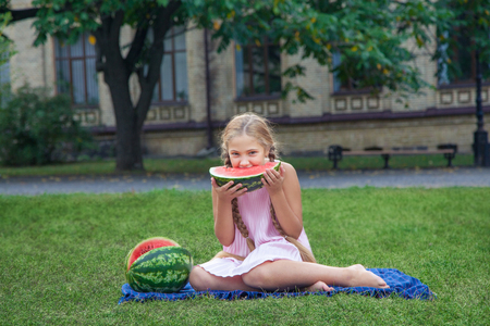 portrait of beautiful girl holding and eating watermelon in the park. Stock fotó