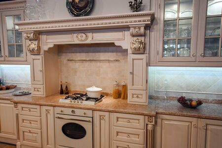 indoor shot of classic luxury kitchen in beige color.