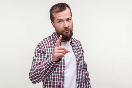 I told you! Portrait of bearded man in plaid shirt standing with raised index finger showing warning gesture, be careful, serious admonishing facial expression. studio shot isolated, white background