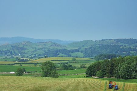 Cutting grass for silage near Kendal, Cumbria, England, UK Stock Photo - 667454